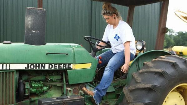Female Member driving tractor
