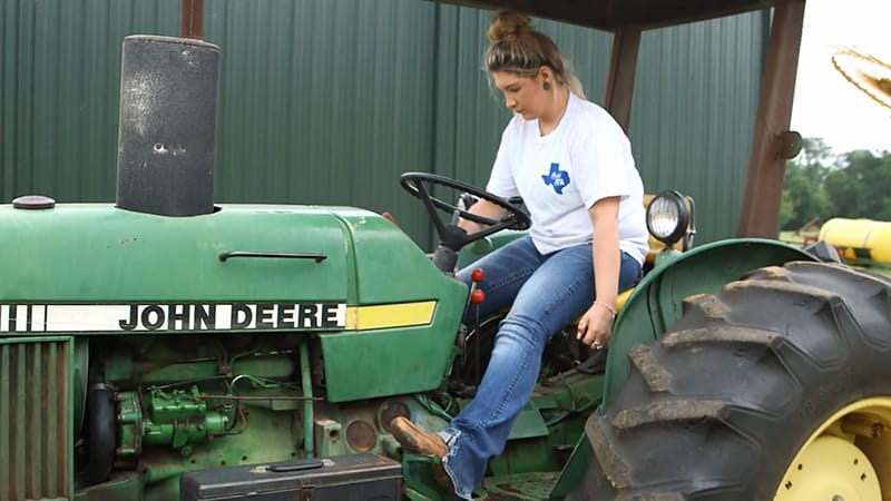 Female Member driving tractor