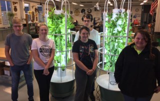 Greensburg FFA members with tower gardens